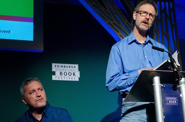 Ron Rash reads while Manuel Rivas looks on