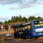 Donated bus in Moss Side Gardens on site of old bus depot in Moss Side, Manchester, UK thumbnail