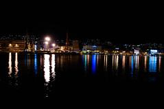 Sea lights reflection (Tomislav C.) Tags: city autumn light sea sky urban reflection night port dark lights industrial waves gulf pentax walk flash croatia calm clear reflector rijeka k7 thepier kvarner theadriatic