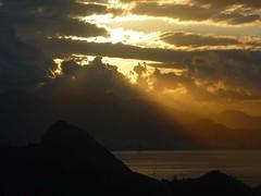 ....WHEN THE SUN AT LAST .... (Umbrae Galeria) Tags: light sunset sea brazil sky sun mer sol riodejaneiro clouds sunrise soleil mar twilight me