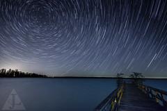Reelfoot Lake Star Trails (Jens Lambert Photography) Tags: lake water stars pier multipleexposure nightsky startrails curvature polaris northstar cyprustrees reelfootlake