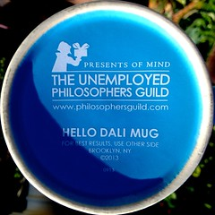 The Unemployed philosophers Guild (Chic Bee) Tags: flower cup mug dali poolside salvadordali hollyhock photostream pun playonwords hellodolly tucsonarizona hellodali philosphers unemployedphilosophersguild mugcupbluehollyhockflowerpink