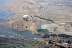 Aerial view of the Coyote Hills and the Dumbarton Bridge toll plaza, Alameda County, California (cocoi_m) Tags: california sanfranciscobay alamedacounty coyotehills flooded aerialphotograph dumbartonbridge tollplaza highway84 openpitmine saltevaporationpond