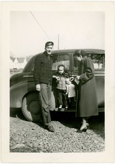 The Doll Goes Everywhere (Alan Mays) Tags: old girls men cars portraits vintage children toys clothing women funny humorous dolls photos antique patterns families humor daughters ephemera mothers clothes photographs snapshots autos amusing coats plaid fathers jackets automobiles borders foundphotos