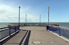 New Brighton Pier (stephen trinder) Tags: blue sea newzealand christchurch sky water fence landscape pier waves quiet shadows empty tide sunday windy nz kiwi aotearoa deserted newbrighton christchurchnewzealand stephentrinder stephentrinderphotography