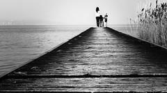 Wait for me (Adrega) Tags: light blackandwhite white lake black water branco river children photography walk mother preto farewell wharf manuel wait fotografia itlia sirmione cais pretobranco 500px ifttt adrega manueladrega