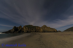 Foot Steps to Clouds (Munish Kaila) Tags: ocean sky beach water rock night clouds stars coast pacific moonlight tides peiffer