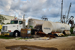 Tanker (FunkadelicSam) Tags: old city blue sunset sky people urban beach rotting clouds trash truck portraits vintage garbage downtown florida grunge vehicle ft tanker decaying tanks myers