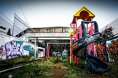 Last Playground (Naughty Danny) Tags: park old bridge wild urban abandoned grass childhood playground horizontal sadness graffiti day loneliness outdoor neglected nopeople barbedwire hollow cloudysky desolation hopeless careless disregarded cyclonemesh unattending