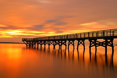 chasing the wind and the Sun ... (, ) (hs_colors) Tags: light orange reflection colors outdoors golden long exposure wind fishingpier yorktownva yorkriver sunrisecolor