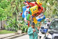 The Balloon seller (Ormastudios) Tags: old man indonesia asia balloon bandung seller