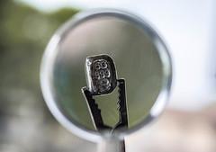 pirate treasure.  lol (-gregg-) Tags: silver magnify glass bokeh clip