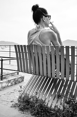 enjoy the sea. (LucaBertolotti) Tags: street sea blackandwhite woman girl beauty bench mare cigarette liguria streetphotography bn streetphoto bnw sigaretta panchina lerici