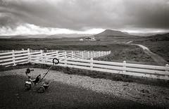 Tricycle, Helgafell near Stykkishlmur, Iceland (cjbj) Tags: blackandwhite film fence iceland nikon fuji tricycle rodinal fm2 acros
