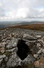 don't fall in (backpackphotography) Tags: ireland megalithic ancient prehistoric wicklow cairn megalith passagetomb seefinhill