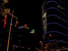 Subliminal Message (Ken Cruz --- Fernweh) Tags: street blue building lines yellow architecture night dark hongkong lights asia cross flag sunlife