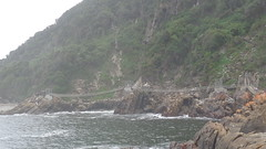 Storms River Mouth Suspension Bridge (Rckr88) Tags: ocean africa travel sea cliff nature water river southafrica outdoors coast south cliffs coastal rivers coastline storms touring gardenroute tsitsikamma easterncape rivermouth rockycoastline tsitsikammanationalpark stormsrivermouth