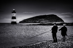 Fishing at Penmon Point, Anglesey, North Wales (Dreampixels LTD) Tags: water monochrome fishing splittone anglesey northwales penmonpoint penmonpointlighthouse