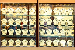 Bling x 40 (Universal Stopping Point) Tags: gold bahrain sunny windowdisplay souq manama necklaces storedisplay