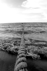 Out to the Ocean (Metography) Tags: ocean blackandwhite beach water cool creative rope malaysia forever leadinglines