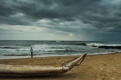 Meanwhile in Chennai (Sarath.kuchi) Tags: morning beach clouds canon boat cloudy 1855mm raining chennai tamilnadu kovalam kovalambeach morninghues canon600d arainymorning canonrebelt3i