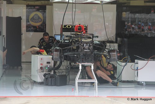 Working on Romain Grosjean's car at the 2013 Spanish Grand Prix