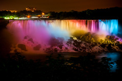 the rainbow falls of niagara (Sam Scholes) Tags: city longexposure blue red newyork water beautiful yellow skyline night digital buildings niagarafalls waterfall rainbow nikon colorful cityscape violet niagara d300 niagarafallsstatepark