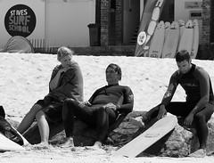 Laid-back (farwest56) Tags: uk england people blackandwhite woman sun man beach mono sand cornwall surfer sony towel surfschool surfboard stives wetsuit bodyboard porthmeor a350