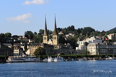 Beautiful Lucerne (Joevimalraj) Tags: blue sky lake tower tourism church beautiful architecture canon river switzerland evening daylight amazing ancient exterior swiss interior basilica churches luzern chapel landmark joe 1855mm lovely dslr devotee monuments devotional lucerne chuch romancatholic array centuries 600d jvr joevimalraj