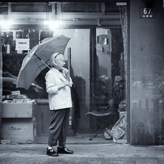 wet evening (bryan-roos) Tags: bw blackandwhite bryanroos bryanroosimaging china evening flickr nex7 portrait puxi rain raining shanghai sonynex7 umbrella wet woman yongkanglu