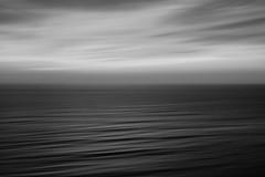 White Sky, Black Sea, Lima (Geraint Rowland Photography) Tags: ocean travel sunset sea sky white painterly black clouds mono paint pacific lima swell blackandwhitesunset sunsetoversea