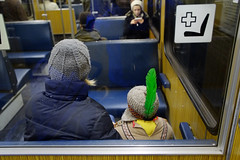 Indian on Metro (harry.f) Tags: boy green germany subway munich metro indian mother feather ubahn fasching carneval karneval harryf pentaxm2828 fujifilmxe1 lensturbo 28on35