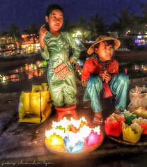 Children selling floating lanterns - Hoi An, Vietnam (lyon photography) Tags: night river children candles traditional vietnam hoian traders floatinglanterns