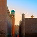 Beautiful view of ancient Itchan Kala fortress at early morning, against the background of bright sunrise sky in Historic Center of Khiva (UNESCO World Heritage Site), Uzbekistan, Central Asia