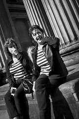 Bars and Stripes (Leanne Boulton) Tags: life lighting street city uk light shadow portrait people urban blackandwhite bw woman sunlight white black detail eye texture monochrome dutch face lines contrast canon photography mono scotland living blackwhite women bars shadows angle faces natural humanity outdoor expression glasgow candid stripes streetphotography angles scene human shade 7d laughter contact tilt tone facial candidstreetphotography