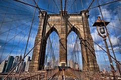 Brooklyn Bridge NY (Kofla Olivieri) Tags: new york newyorkcity bridge ny manhattan landmark walkway boardwalk cityskyline thebigapple brooklynbridgepark adobephotoshopelements theeastriver topazadjust