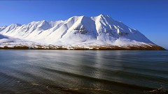 Northfjord reverie (lunaryuna) Tags: light sea panorama sunlight snow mountains ice water season landscape coast iceland spring fjord lunaryuna waterscape siglufjordur northiceland seasonalchange lightmood northfjords