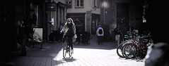 * (Gwenal Piaser) Tags: street light woman france bicycle backlight canon eos prime reflex outdoor gimp 85mm strasbourg alsace usm fullframe rue bicyclette canoneos velo contrejour 6d 85mmf18 24x36 ef85mm ef85mmf18usm canonef85mmf18usm ef85mmusm eos6d rawtherapee unlimitedphotos canonef85mm118usm canoneos6d gwenaelpiaser