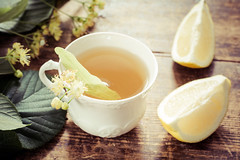 Tea with lemon and linden (Arx0nt.) Tags: summer cup water glass yellow closeup golden ginger wooden leaf lemon energy warm tea drink background linden rustic health medicine flue porcelain herbal aroma boost immunesystem bloodpressure healthydrink