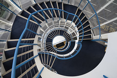 STARE CASE (jpfpreston) Tags: street city blue urban white abstract color london lines architecture zeiss point spiral design colorful background sony steps creative symmetry treppe staircase symmetrical handrail alpha vanishing carlzeiss wendeltreppe a7ii starecase joshuapreston sel1635z ilce7m2 stairgasm