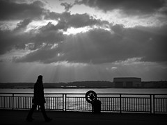 fiat lux (vfrgk) Tags: light sky blackandwhite bw monochrome silhouette walking lightandshadows couple cloudy lightbeams manandwoman waterscape strolling
