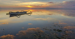 The Jukung of Bali (Hafiz.Soyuz.Photography) Tags: trip bali seaweed reflection beach clouds sunrise landscapes boat photo seascapes tide low sanur karang jukong