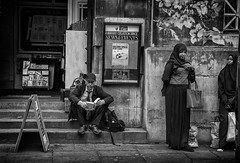 bristol street life- (Daz Smith) Tags: city uk portrait people urban blackandwhite bw woman man streets blancoynegro monochrome canon paper bristol blackwhite bath candid citylife thecity streetphotography busstop sitiing reaing canon6d dazsmith