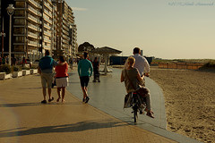 Belgian coast (Natali Antonovich) Tags: portrait beach bike walking seaside belgium belgique belgie walk lifestyle promenade relaxation seashore seasideresort belgiancoast seaboard newpoort
