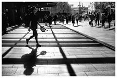 Commuter (catskinroyale) Tags: morning trainstation fuji silouette monochrome blackandwhite shadows rushhour kingscross london