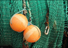 Floats and nets (catb -) Tags: ireland sea orange green pier boat harbour chain nets waterford fa buoy helvick buoyant