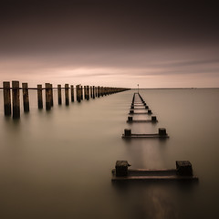 Broken pier (Scott Baldock Photography) Tags: uk sea england seascape reflection london beach water thames river landscape coast pier seaside nikon long exposure jetty ministry great shoreline calm boom estuary east filter essex ultra pipeline shoeburyness defence garrison density lightroom southendonsea neutral eastbeach shoebury wakering nd110 d7000 scottbaldockphotography