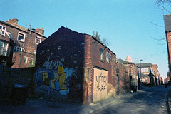 Back Blenheim Terrace (Saturated Imagery) Tags: house color film toxic 35mm graffiti iso100 grain leeds dlsr c41 artfilm vivitar28mmf25 epsonv500 prakticatl5b agphotographic photoshopelements9 adoxcolorimplosion