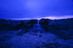untitled (Noisy Paradise) Tags: leica longexposure blue sea sky seascape film japan night twilight rocks dusk epson fujifilm bluehour m6 provia100f carlzeiss biogon zm japanatnight  gtx970 rdp carlzeisscbiogont4521zm outoftheblueandintotheblack noisyparadise cbiogont4521