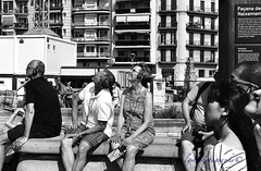Tourists Awed by Beauty (Halcon122) Tags: barcelona street camera bw outside spain raw sitting cathedral candid watching streetphotography stranger tourists headset sagradafamilia sacredfamily epm2
